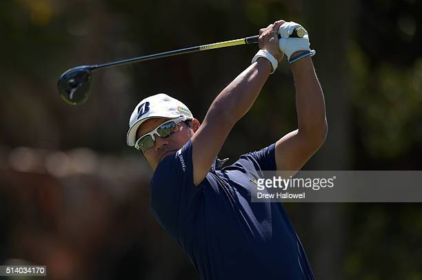 Yusaku Miyazato of Japan tees off on the 12th hole during the final round of the World Golf ChampionshipsCadillac Championship at Trump National...
