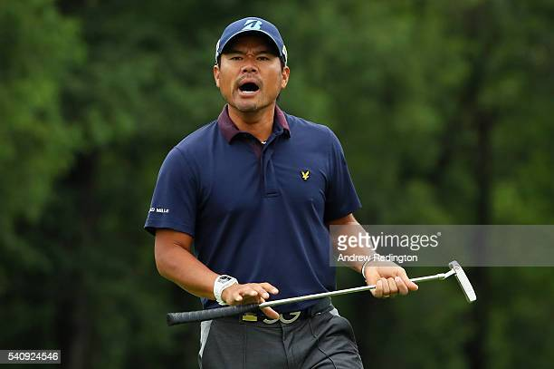 Yusaku Miyazato of Japan walks across a green during the continuation of the weather delayed first round of the US Open at Oakmont Country Club on...