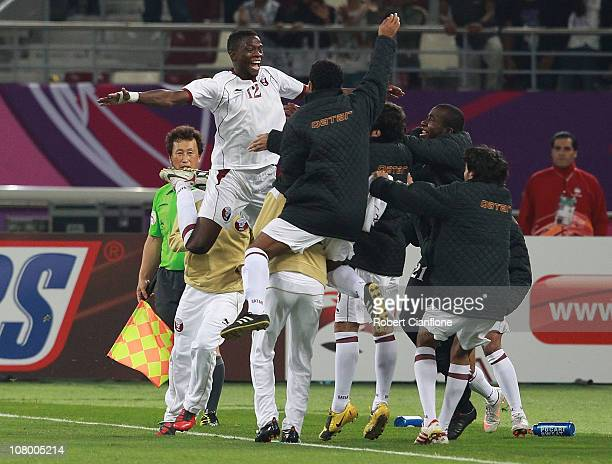 Yusef Ahmed of Qatar celebrate his teams second goal during the AFC Asian Cup Group A match between China PR and Qatar at Khalifa Stadium on January...
