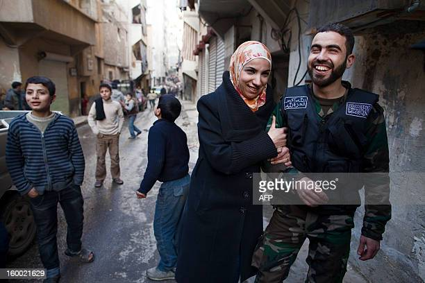 PAMPLIEGA Yusef and Ghada pose in a street after getting married in the Sukkari district of Aleppo in northern Syria on January 17 2013 Ghada and...