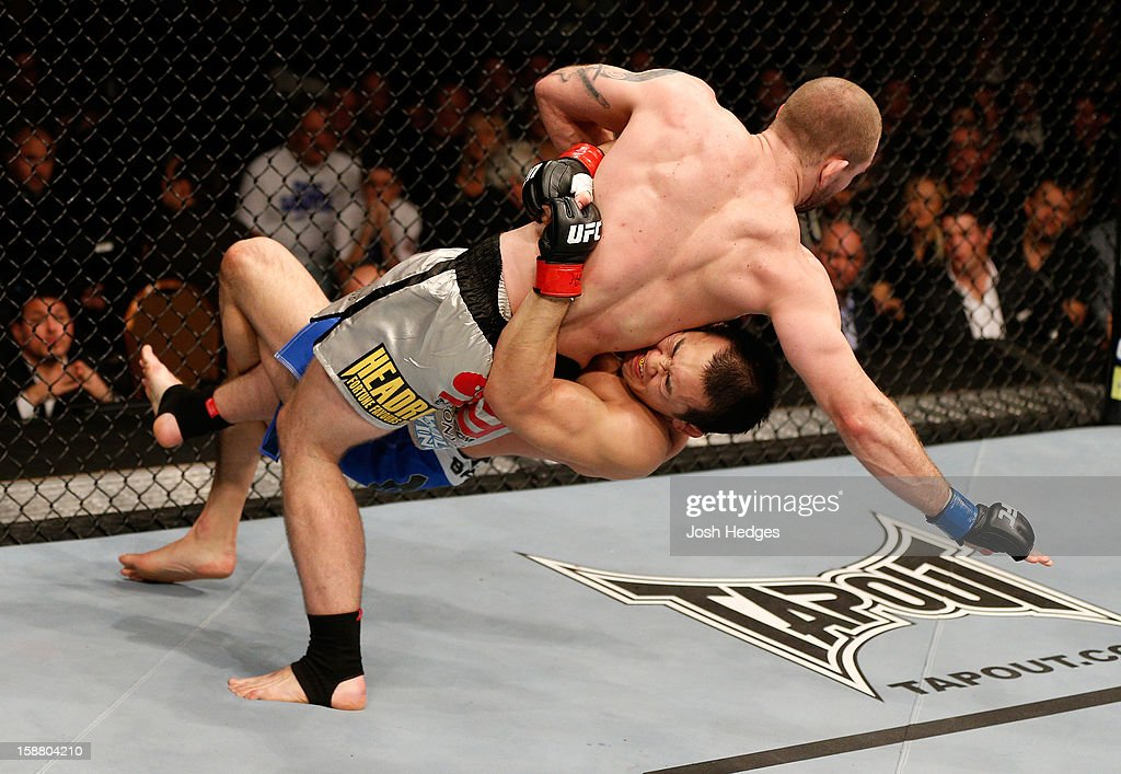 Yushin Okami (bottom) lifts Alan Belcher during their middleweight fight at UFC 155 on December 29, 2012 at MGM Grand Garden Arena in Las Vegas, Nevada.