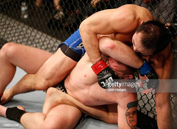 Yushin Okami punches Alan Belcher during their middleweight fight at UFC 155 on December 29 2012 at MGM Grand Garden Arena in Las Vegas Nevada