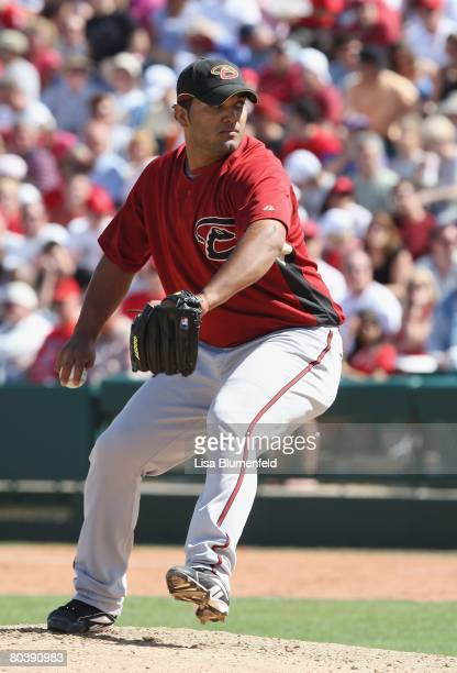 Yusmeiro Petit of the Arizona Diamondbacks pitches during a Spring Training game against the Los Angeles Angels of Anaheim at Tempe Diablo Stadium on...