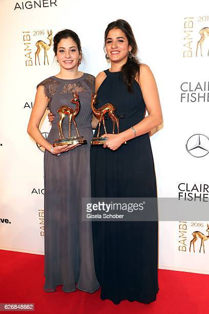 Yusra and her sister Sarah Mardini with award during the Bambi Awards 2016 at winners board at Stage Theater on November 17 2016 in Berlin Germany