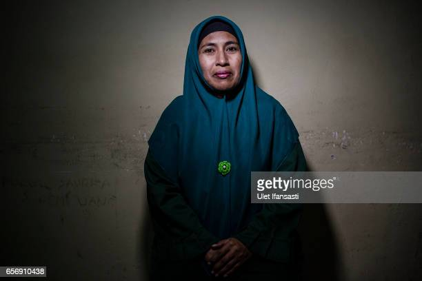 Yusra has eleven years as a member of the sharia police woman known as Wilayatul Hisbah poses to photograph on March 22 2017 in Banda Aceh Indonesia...