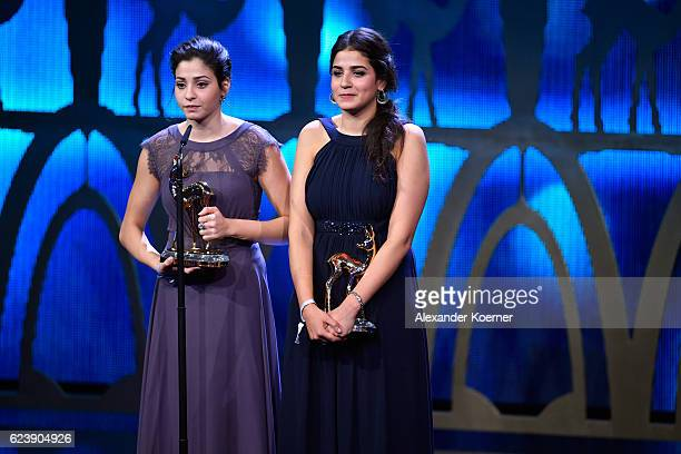 Yusra Mardini and Sarah Mardini are seen on stage during the Bambi Awards 2016 show at Stage Theater on November 17 2016 in Berlin Germany