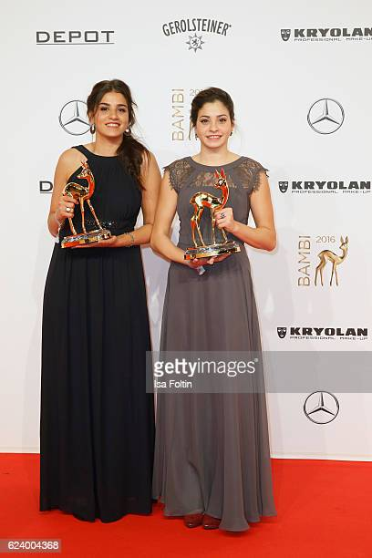 Yusra Mardini and Sarah Mardini pose with award at the Bambi Awards 2016 winners board at Stage Theater on November 17 2016 in Berlin Germany