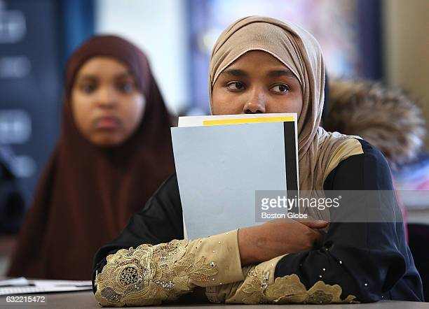 Yusra Mohamed right listens to information from two immigration attorneys during a workshop titled 'Find Your Voice Muslim Community at BINcA' at...