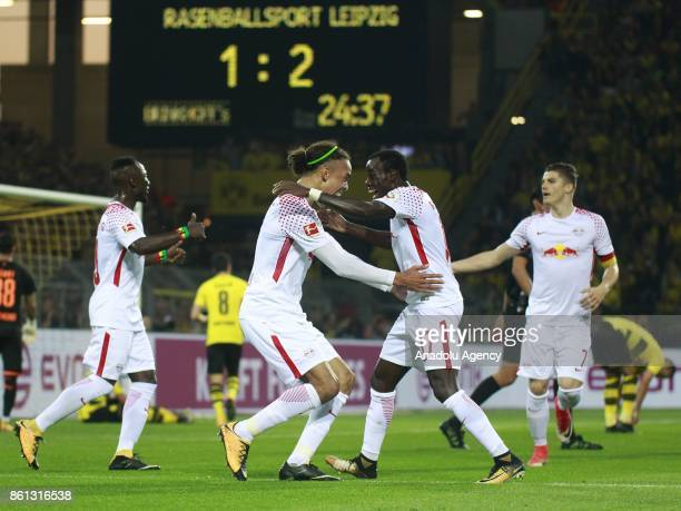 Yussuf Poulsen and Bruma of Rasenballsport Leipzig celebrate after scoring a goal during the Bundesliga soccer match between Borussia Dortmund and...