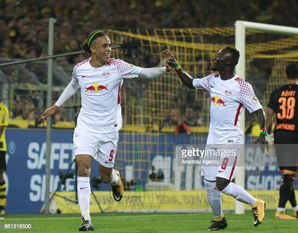 Yussuf Poulsen and Naby Keita of Rasenballsport Leipzig celebrate after scoring a goal during the Bundesliga soccer match between Borussia Dortmund...