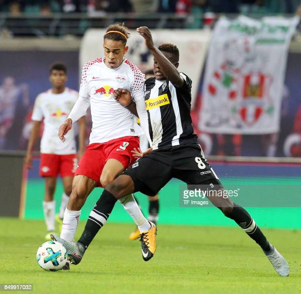Yussuf Poulsen of Leipzig and Denis Zakaria of Moenchengladbach battle for the ball during the Bundesliga match between RB Leipzig and Borussia...