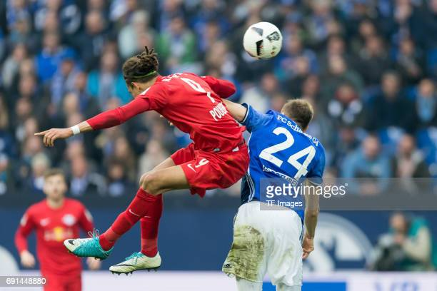 Yussuf Poulsen of Leipzig and Holger Badstuber of Schalke battle for the ball during the Bundesliga match between FC Schalke 04 and RB Leipzig at...