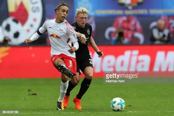 Yussuf Poulsen of Leipzig battles for the ball with Andreas Beck of Stuttgart during the Bundesliga match between RB Leipzig and VfB Stuttgart at Red...