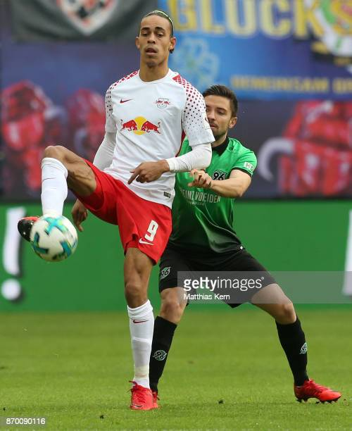 Yussuf Poulsen of Leipzig battles for the ball with Julian Korb of Hannover during the Bundesliga match between RB Leipzig and Hannover 96 at Red...