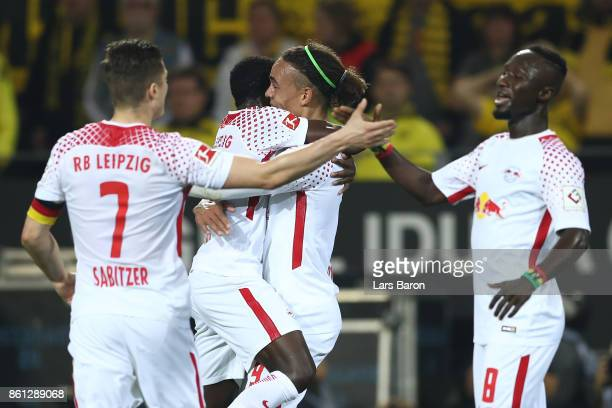 Yussuf Poulsen of Leipzig celebrates with fellow players after he scores his teams second goal to make it 12 during the Bundesliga match between...