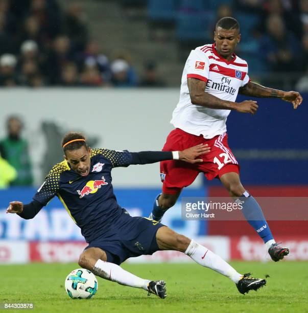 Yussuf Poulsen of Leipzig is challenged by Walace of Hamburg during the Bundesliga match between Hamburger SV and RB Leipzig at Volksparkstadion on...