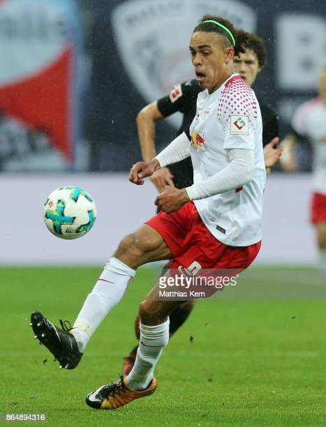 Yussuf Poulsen of Leipzig runs with the ball during the Bundesliga match between RB Leipzig and VfB Stuttgart at Red Bull Arena on October 21 2017 in...