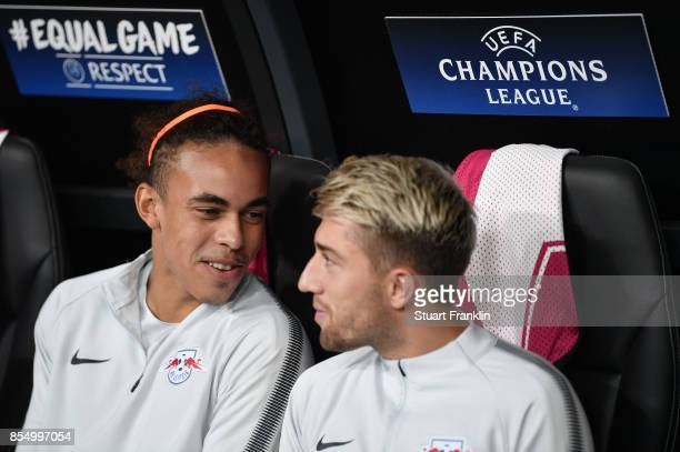 Yussuf Poulsen of Leipzig talks with Kevin Kampl on the subsitutes bench during the UEFA Champions League second leg group G match between Besiktas...