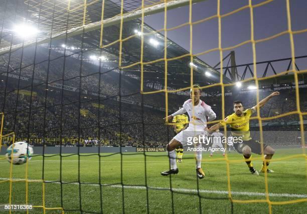 Yussuf Poulsen of Rasenballsport Leipzig scores a goal as he vies with Sokratis Papastatopulos of Borussia Dortmund during the Bundesliga soccer...