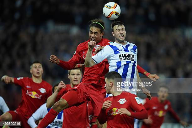 Yussuf Poulsen of RB Leipzig and Jonas Meffert of Karlsruhe jump for a header during the Second Bundesliga match between Karlsruher SC and RB Leipzig...