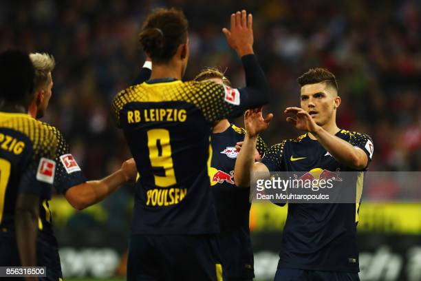 Yussuf Poulsen of RB Leipzig celebrates scoring his teams second goal of the game with team mates r7 during the Bundesliga match between 1 FC Koeln...