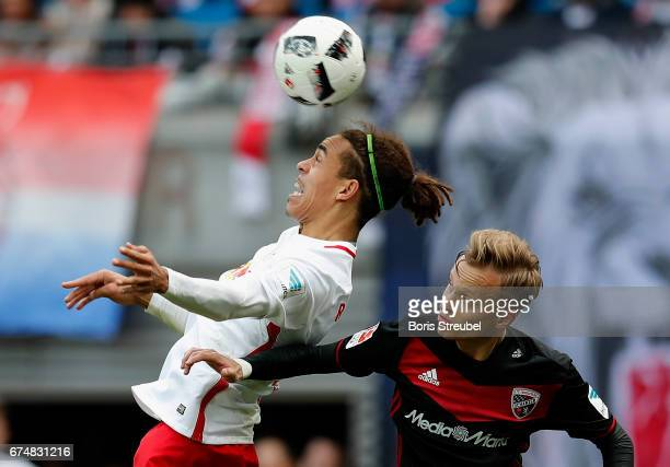 Yussuf Poulsen of RB Leipzig jumps for a header with Florent Hadergjonaj of FC Ingolstadt 04 during the Bundesliga match between RB Leipzig and FC...