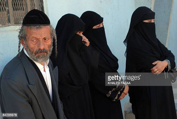 Yussuf the father of a Yemeni Jew killed earlier this month in Raydah 70 kms north of the capital Sanaa stands with his daughters outside a court...