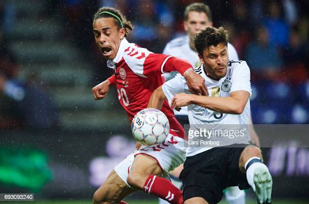 Yussuf Yurary Poulsen of Denmark and Jonas Hector of Germany compete for the ball during the international friendly match between Denmark and Germany...