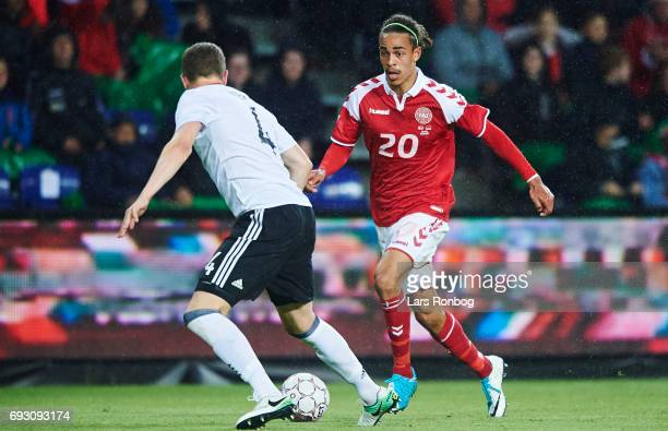 Yussuf Yurary Poulsen of Denmark and Matthias Ginter of Germany for the ball during the international friendly match between Denmark and Germany at...