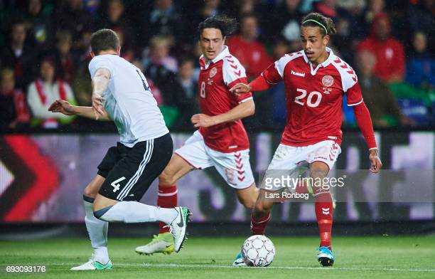 Yussuf Yurary Poulsen of Denmark Thomas Delaney of Denmark and Matthias Ginter of Germany compete for the ball during the international friendly...
