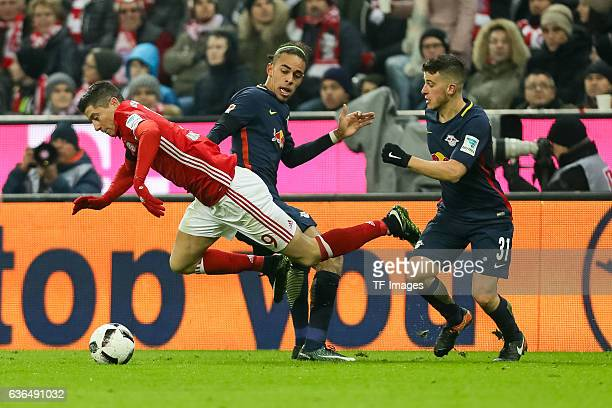 Yussuf Yurary Poulsen of Leipzig Diego Demme of Leipzig and Robert Lewandowski of Muenchen battle for the ball during the Bundesliga match between...