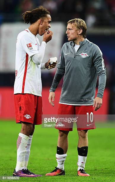 Yussuf Yurary Poulsen of Leipzig shows his loose tooth to Emil Forsberg during the Bundesliga match between RB Leipzig and FC Augsburg at Red Bull...
