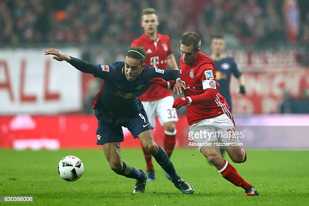 Yussuf Yurary Poulsen of RB Leipzig and Philipp Lahm of Bayern Muenchen battle for possession during the Bundesliga match between Bayern Muenchen and...
