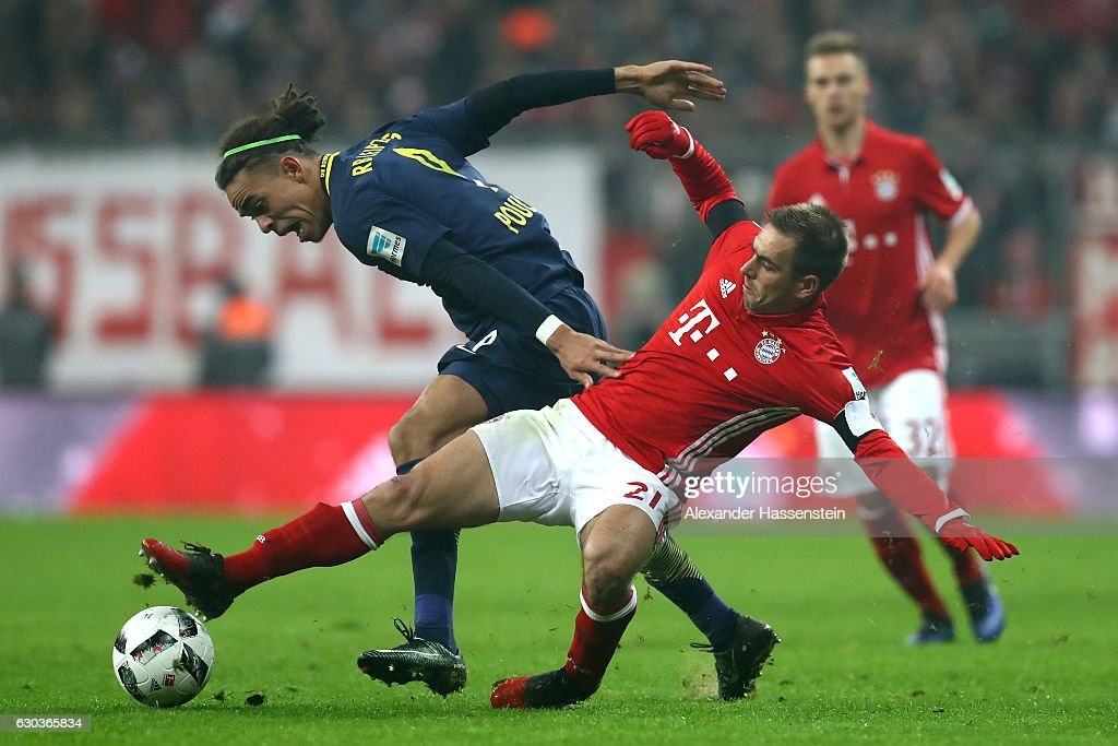Yussuf Yurary Poulsen of RB Leipzig (L) is tackled by Philipp Lahm of Bayern Muenchen (R) during the Bundesliga match between Bayern Muenchen and RB Leipzig at Allianz Arena on December 21, 2016 in Munich, Germany.