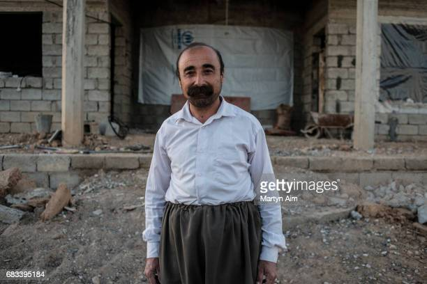 Yusuf 46 years old is Kaka'i an ethnoreligious minority in Iraq He stands in front of his damaged home in Tel Laban village in the Nineveh plains of...