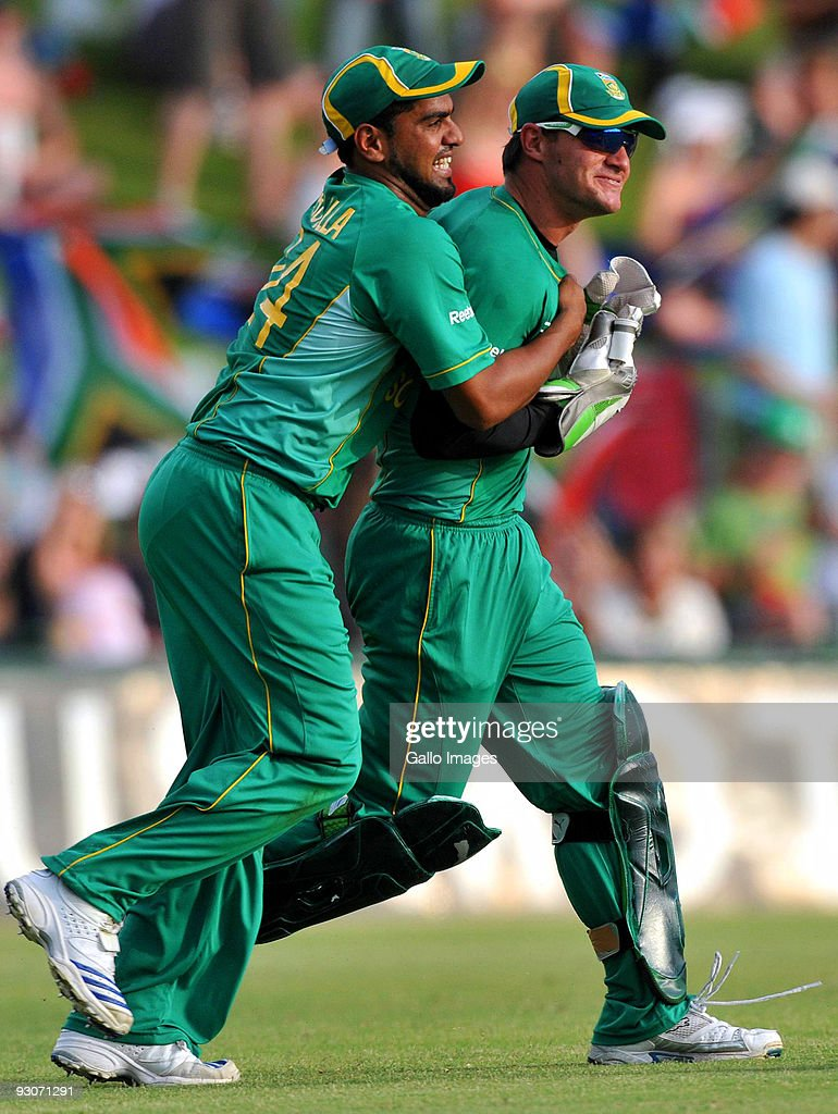 Yusuf Abdulla and Heino Kuhn of South Africa celebrate the wicket of Jonathan Trott of England during the 2nd Twenty20 international match between South Africa and England at SuperSport Park Stadium on November 15, 2009 in Centurion, South Africa.