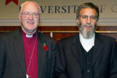 Yusuf Islam formerly known as Cat Stevens poses for photographs with the first chancellor George Carey who was Archbishop of Canterbury after he was...