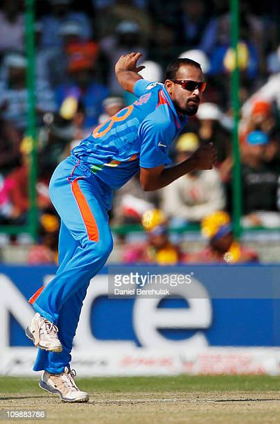Yusuf Pathan of India bowls during the 2011 ICC Cricket World Cup Group B match between India and the Netherlands at Feroz Shah Kotla stadium on...
