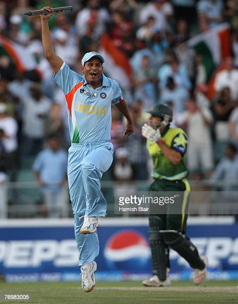 Yusuf Pathan of India celebrates his team's win with MisbahulHaq of Pakistan looking on after the Twenty20 Championship Final match between Pakistan...
