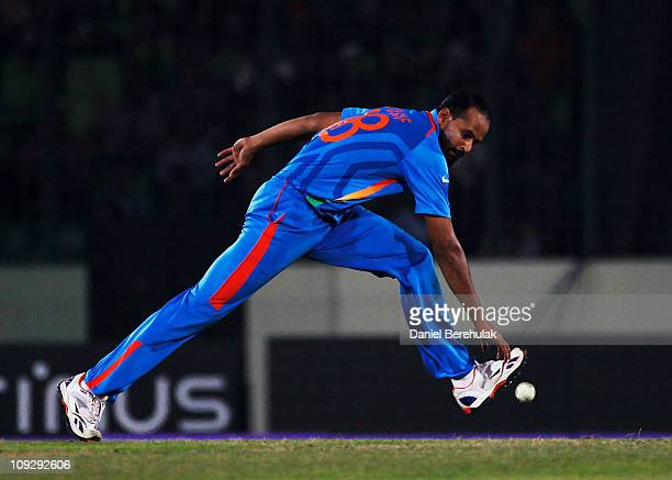Yusuf Pathan of India fields off his own bowling during the opening game of the ICC Cricket World Cup between Bangladesh and India at the...