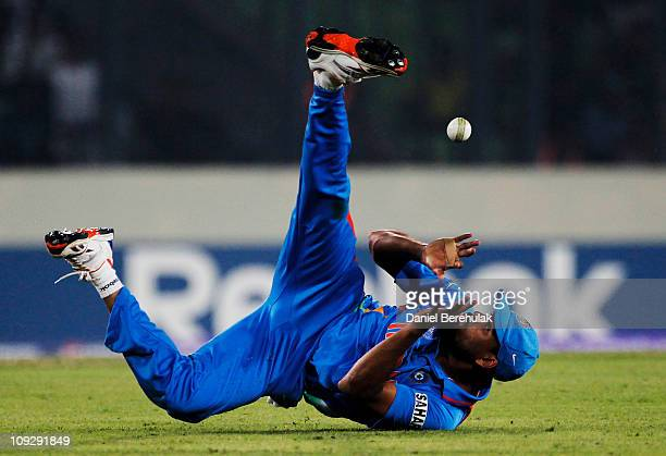 Yusuf Pathan of India tries to regather the ball as he drops a catch during the opening game of the ICC Cricket World Cup between Bangladesh and...