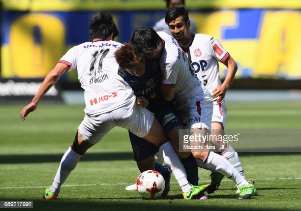 Yusuke Goto of Oita Trinita competes for the ball against Park Hyung Jin Shohei Takeda and Kazuhito Watanabe of Fagiano Okayama during the JLeague J2...