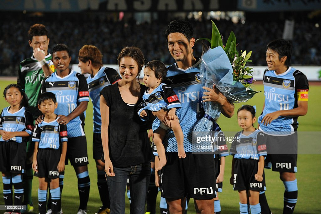 Yusuke Igawa of Kawasaki Frontale celebrates his 200th match of JLeague Division1 prior to the JLeague match between Kawasaki Frontale and Sanfrecce...