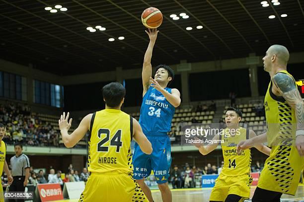 Yusuke Karino of the Shiga Lakestars shoots over Kenta Hirose of the SunRockers during the B League match between Hitachi SunRockers TokyoShibuya and...