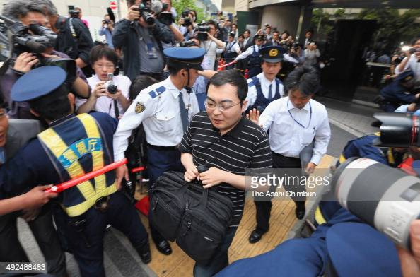 Yusuke Katayama leaves his lawyer's office and is taken away by officials with the public prosecutors' office on May 20 2014 in Tokyo Japan Katayama...