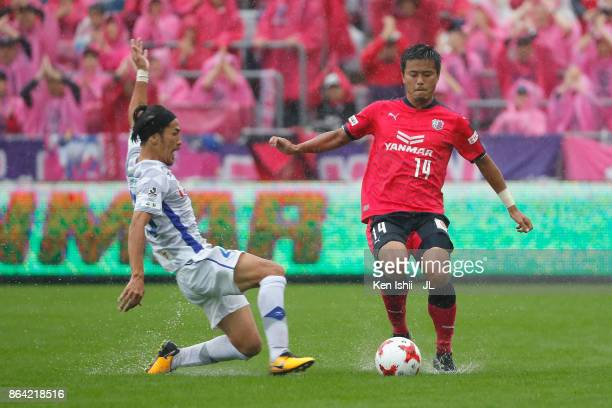 Yusuke Maruhashi of Cerezo Osaka and Shohei Ogura of Ventforet Kofu compete for the ball during the JLeague J1 match between Cerezo Osaka and...