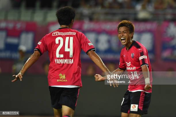 Yusuke Maruhashi of Cerezo Osaka celebrates scoring his side's fourth goal with his team mate Kazuya Yamamura during the JLeague J1 match between...