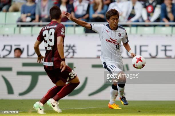 Yusuke Maruhashi of Cerezo Osaka takes on Masahiko Inoha of Vissel Kobe during the JLeague J1 match between Vissel Kobe and Cerezo Osaka at Noevir...