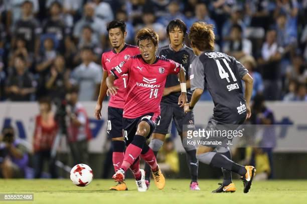 Yusuke Maruhashi of Cerezo Osaka takes on Shohei Takahashi of Jubilo Iwata during the JLeague J1 match between Jubilo Iwata and Cerezo Osaka at...