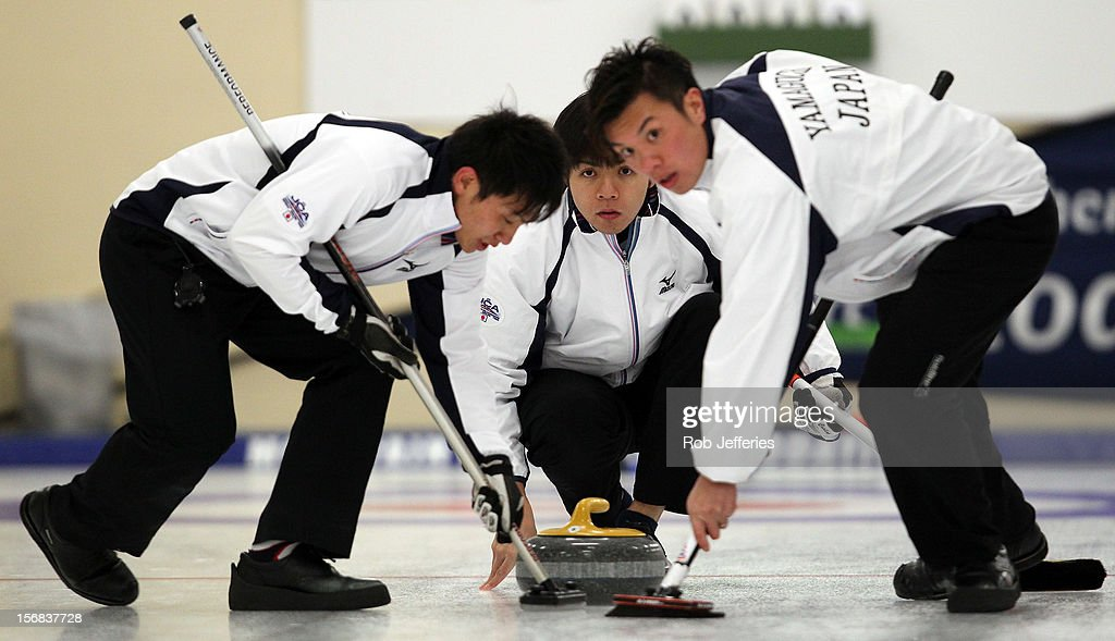 Yusuke Morozumi of Japan delivers a stone during the Pacific Asia 2012 Curling Championship at the Naseby Indoor Curling Arena on November 23, 2012 in Naseby, New Zealand.